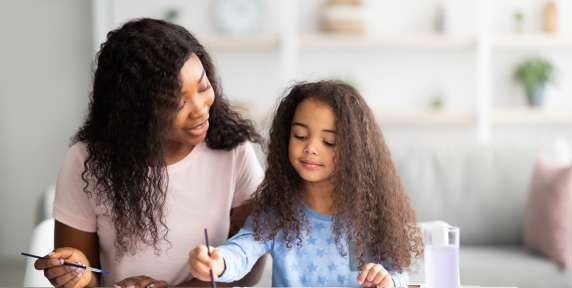 portrait-of-happy-black-mother-and-her-daughter-painting-with-watercolors-and-gouache-at-home-family-hobbies-concept-217018368